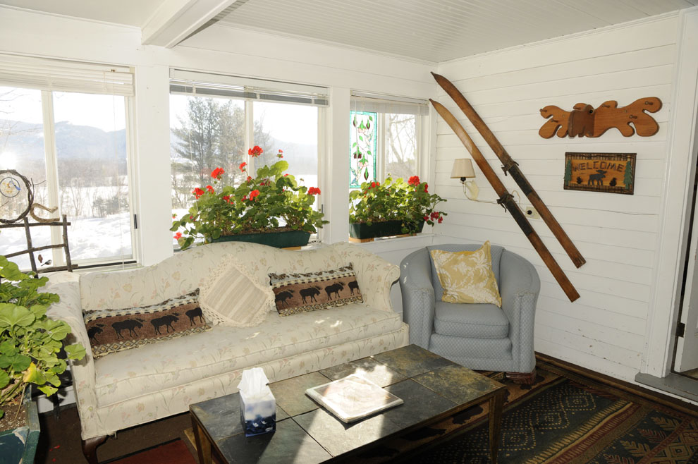 Enjoy sunshine, year- round in this heated sun room with views of the horses and mountains.